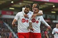 Football - 2017 / 2018 Premier League - AFC Bournemouth vs. Southampton<br /> <br /> Southampton's Charlie Austin with Southampton's Sofiane Boufal and Southampton's Ryan Bertrand celebrate his goal at Dean Court (Vitality Stadium) Bournemouth <br /> <br /> COLORSPORT/SHAUN BOGGUST