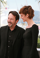 Actor Jean-Hugues Anglade and actress Louise Bourgoin at the Je Suis Un Soldat – I Am A Soldier film photo call at the 68th Cannes Film Festival Tuesday May 20th 2015, Cannes, France.
