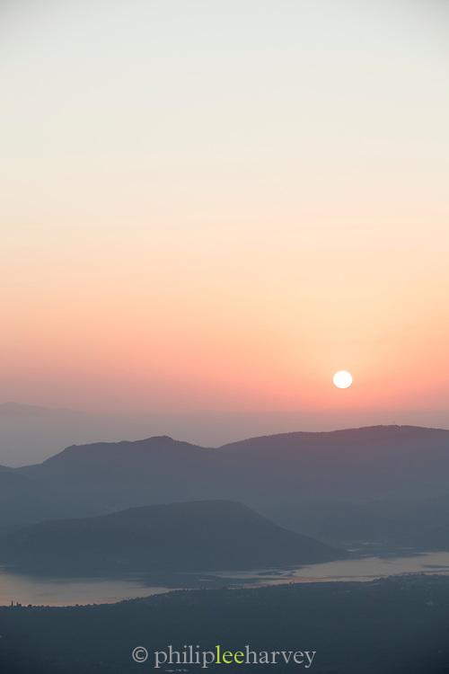 High angle view of foggy sunrise over mountain landscape, Plomari, Lesbos, Greece