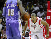 March 15, 2010; Houston, TX, USA; Houston Rockets guard Shane Battier (31) defends Denver Nuggets forward Carmelo Anthony (15) in the third period at the Toyota Center.  The Rockets won 125-123. Mandatory Credit: Thomas Campbell-US PRESSWIRE