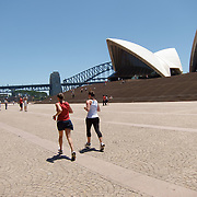 Girls running (jogging) in front of Sydney Opera House in Sydney Bay Sydney Opera House.