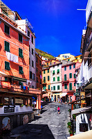 """""""Spring afternoon stroll in Riomaggiore""""...<br /> <br /> I began my daily journey at the northern most town of Monterosso and took the train to the southernmost town of Riomaggiore. Upon arriving in this picturesque seaside village and moving down to the water's edge, I noticed proprietor Francesco in front of a tiny boat rental sign.  After arranging an evening sail up the coast, I was able to focus on the colorful persona of Riomaggiore. That evening I sailed up the coast photographing each Cinque Terre town along the way aboard the Angelina Dada. Upon arriving back home in Monterosso, soft light illuminated the sky and azure sea of the Mediterranean convincing me to sail all the way back to Riomaggiore with my gracious guides Claudio and Eddie of """"Cinque Terre dal Mare"""" sailing excursions. We arrived just in time for a perfect sunset. After a nice dinner...I caught the last train at midnight back home to Monterosso. A very long day, but worth every minute!"""
