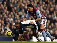 Photo: Chris Ratcliffe.<br />Tottenham Hotspur v Aston Villa. The Barclays Premiership. 21/01/2006.<br />Edgar Davids (L) is brought down by Milan Baros of Villa.