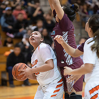 Gallup's Hailey Long (40) looks to the basket while Marielynn Lansing (40) defends for Shiprock in their matchup Friday night at Gallup High School.