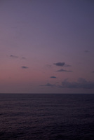 Pastel colored sky and clouds over the Pacific Ocean at dawn.  Image 21 of 21  for a panorama taken with a Fuji X-T1 camera and 35 mm f/1.4 lens  (ISO 400, 35 mm, f/2.8, 1/30 sec). Raw images processed with Capture One Pro and stitched together with AutoPano Giga Pro.