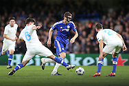 Rubén Neves of FC Porto tackles Nemanja Matic of Chelsea (c). UEFA Champions league group G match, Chelsea v Porto at Stamford Bridge in London on Wednesday 9th December 2015.<br /> pic by John Patrick Fletcher, Andrew Orchard sports photography.