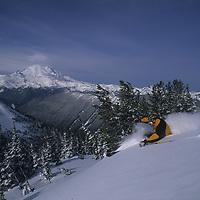 Keith Rollins skis powder at Crystal Mountain, Washington, Mt. Rainier bkg.