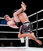 EDMONTON, ALBERTA: Nov 23, 2007 - Gavin Neil is slammed to the mat by Jason Zorthian in a mixed martial arts bout at the Maximum Fighting Championships in Edmonton Alberta. Neil would go on to win the bout by choke at 2:20 of the first round. Photo by Arnold Lim