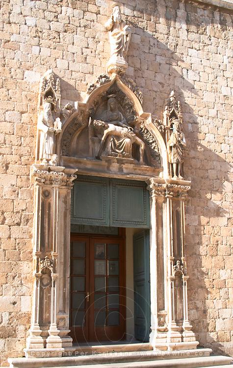 The entrance portico to the Mala Braca Saint Franciscan church cloister Dubrovnik, old city. Dalmatian Coast, Croatia, Europe.