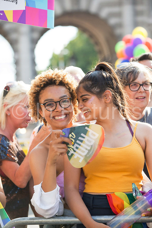 A carnival atmosphere during the Pride in London parade near Trafalgar Square on the 7th July 2018 in central London in the United Kingdom. 30,000 marched through central London for the city's annual LGBT Pride celebration.