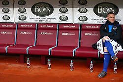 Everton's Wayne Rooney sits on the bench during the Premier League match at Turf Moor, Burnley.