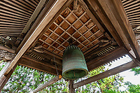 """Tatsueji Temple Bell- Tatsue-ji is the first """"Sekisho"""" temple, there being one in each of the four prefectures of Shikoku. Sekisho were the """"barriers"""" or control points on highways in Japan from ancient times up until the late 19thcentury. Government officials would check the papers and passes of people traveling to make sure they had permission. Sekisho temples are a kind of spiritual checkpoint with the idea being that if you do not have the correct spiritual and mental attitude for the pilgrimage you should go back to the beginning and start again. There are even stories of people feeling unable to enter the grounds. The legend here is that of  a woman named Okyo who worked as a geisha, killed her husband and ran away with lover. They attempted a double suicide, but they decided to do become pilgrims instead. When got to this temple, her black hair twined around the bell, roped around her black hair and her head skin fell off."""