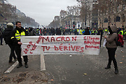 December, 8th, 2018 - Paris, Ile-de-France, France: Anti Macron banner poster shown at Champs Elysees demonstration. The French 'Gilets Jaunes' demonstrate a fourth day. Their movement was born against French President Macron's high fuel increases. They have been joined en mass by students and trade unionists unhappy with Macron's policies. Nigel Dickinson