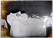 elderly woman laying in state in bed at home 1900s France