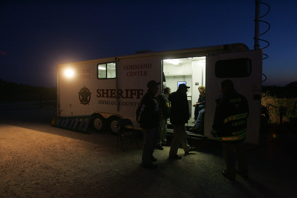San Manuel, TX - 19 Mar 2008 -.Hidalgo County emergency management officials meet at a command post along FM 1017 as dawn breaks on Wednesday morning with the fire only partially contained..Photo by Alex Jones / ajones@themonitor.com