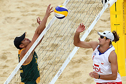 Grant Goldschmidt of South Africa and Mariusz Prudel of Poland during the preliminary phase - Pool D Beach Volleyball match between Poland and South Africa held at the Horse Guards Parade Stadium in London as part of the London 2012 Olympics on the 1st August 2012..Photo by Ron Gaunt/SPORTZPICS