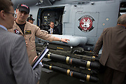 US Navy pilot shows guests Hellfire missiles on his Sikorsky MH-60R helicopter at the Farnborough Airshow. ..The MH-60R is the U.S. Navy's newest and most advanced multi-mission helicopter, designed for anti-submarine and surface warfare (ASW/ASuW). Secondary missions include: Search and Rescue, anti-ship surveillance and targeting, communication relay and medevac/vertical replenishment. The Sikorsky-built helicipter with integrated avionics and mission systems by Lockheed Martin.