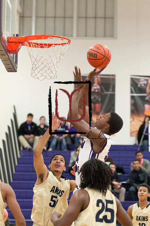 Cedar Ridge's Tim Holland attempts a basket against Akins Tuesday evening at home.  The Raiders beat the Eagles 80-78.  (LOURDES M SHOAF for Round Rock Leader.)