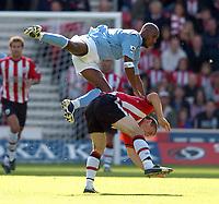 Fotball<br /> 2004/2005<br /> Foto: SBI/Digitalsport<br /> NORWAY ONLY<br /> <br /> The Barclays Premiership.<br /> <br /> Southampton v Manchester City<br /> 02.10.2004<br /> <br /> Nicolas Anelka of City tumbles over Saints' David Prutton