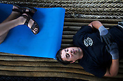 Sea Shepherd crew Warren Werrett and Laurens De Groot, from left, nap on ropes on the deck of the M/Y Steve Irwin on Thursday, on Dec. 4, 2008. Amid the frenzy of campaign, crew sometimes struggle to find downtime to rest. (Photo by Adam Lau)