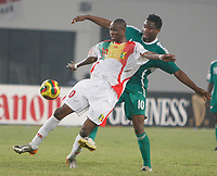 Photo: Steve Bond/Richard Lane Photography.<br /> Nigeria v Mali. Africa Cup of Nations. 25/01/2008. Dramane Traore (front) shields the ball from John Obi Mikel (back)