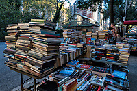 Stacks of books for sale on Broadway, New York City.