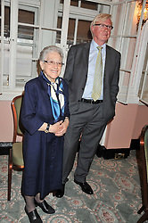 MIKE HOLLINGSWORTH and ELENA SALVONI at the 20th anniversary reception for The Oldie Magazine held at Simpsons in The Strand, London on 19th July 2012.