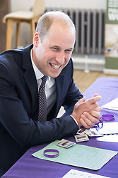 """© Licensed to London News Pictures . 14/09/2017 . Liverpool , UK . The Duke of Cambridge , Prince William , sits in front of a sheet of paper with """" Wills """" and a heart and kisses written on it , left by women from the Stroke Association , during a visit to Life Rooms in Walton . Life Rooms provides community support to help people recover from mental health issues . Photo credit : Joel Goodman/LNP"""