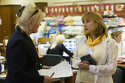 Moscow, Russia, 18/06/2006..A member of staff assisting customers in a branch of the Shatura furniture store chain.