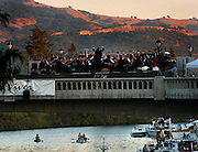 Napa Valley Symphony conductor Asher Raboy leads the symphony in a performance on the new Third St. bridge over the Napa River during the annual River Festival in August 2003.