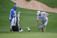 Matt Jones (AUS) takes his shoes and socks off to hit from the water near the green on 18 during day 3 of the Valero Texas Open, at the TPC San Antonio Oaks Course, San Antonio, Texas, USA. 4/6/2019.<br /> Picture: Golffile | Ken Murray<br /> <br /> <br /> All photo usage must carry mandatory copyright credit (© Golffile | Ken Murray)