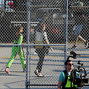 Danica Patrick, driver of the (7) GoDaddy Chevrolet exits  through a security fence from the garage area after practice for the 60th Annual NASCAR Daytona 500 auto race at Daytona International Speedway on Friday, February 16, 2018 in Daytona Beach, Florida.  (Alex Menendez via AP)
