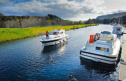 Cabin cruiser approaching it's mooring on the Caledonian Canal at Dochgarroch, Inverness-shire, Scotland.<br /> <br /> (c) Andrew Wilson | Edinburgh Elite media