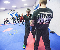 Students punching as Stef Noij, KMG Instructor from the Institute Krav Maga Netherlands, takes the IKMS G Level Programme seminar today at the Scottish Martial Arts Centre, Alloa.