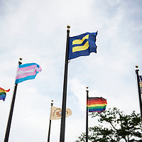 Various LGBT pride flags fly in front of the Navajo Nation Council Chambers for the first time in celebration of DinéPride 2019 in Window Rock.