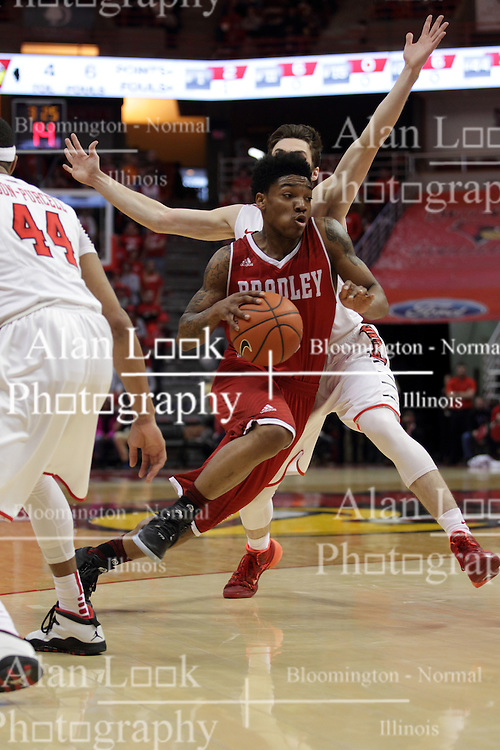 14 February 2016: Antoine Pittman cuts between DeVaughn Akoon-Purcell(44) and Justin McCloud(15) during the Illinois State Redbirds v Bradley Braves at Redbird Arena in Normal Illinois (Photo by Alan Look)