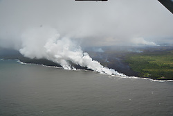 Handout photo taken on May 20, 2018 of KÄ«lauea Volcano — Plume Rising. Ocean entry photograph from Civil Air Patrol (CAP) overflight taken at about 12:50PM. CAP operates to support the mission of both the USGS HVO and the Hawaii County Civil Defense. Hard to discern here, but there are two entries. The coastal area spanning the entry is about 1 km (0.6 mi) wide with an about 250 m (0.15 mi) KÄ«puka separating the two. Photo by usgs via ABACAPRESS.COM