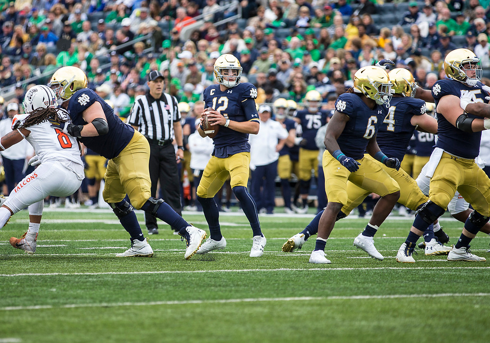 October 05, 2019:  Notre Dame quarterback Ian Book (12) passes the ball during NCAA football game action between the Bowling Green Falcons and the Notre Dame Fighting Irish at Notre Dame Stadium in South Bend, Indiana.  Notre Dame defeated Bowling Green 52-0.  John Mersits/CSM.