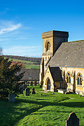 St Barnabas Church, 19th Century Victorian architecture, and old graves in graveyard at Snowshill village in The Cotswolds, England