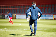 Groundsman collecting warmup balls during the EFL Sky Bet League 2 match between Stevenage and Bradford City at the Lamex Stadium, Stevenage, England on 5 April 2021.