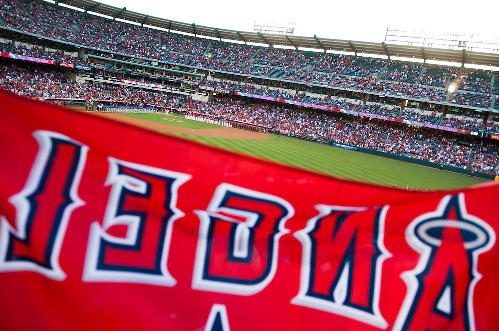 Erin Edgards and Ricky Hainey, 11, both of Hemet, hold up an Angels flag before the Angels' home opener Monday at Angel Stadium.<br /> <br /> ///ADDITIONAL INFO:   <br /> <br /> angels.0405.kjs  ---  Photo by KEVIN SULLIVAN / Orange County Register  --  4/4/16<br /> <br /> The Los Angeles Angels take on the Chicago Cubs during their 2016 home opener Monday at Angel Stadium.<br /> <br /> <br />  4/4/16
