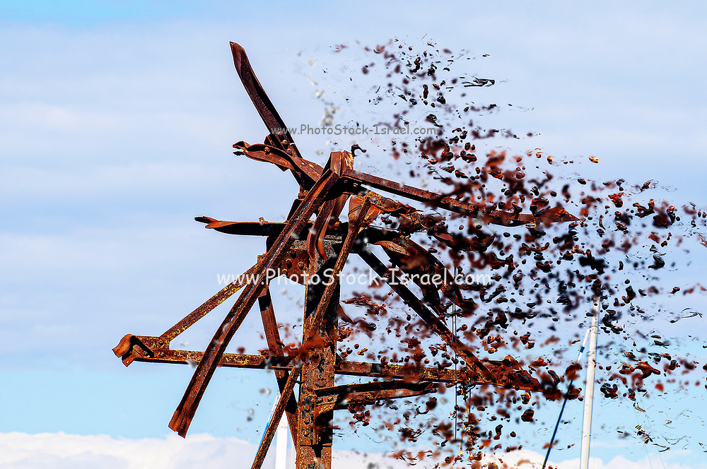 Digitally enhanced image of an Old, rusted and decaying metal pylon from a demolished warehouse building with blue sky background
