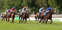 Spring Cosmos (right) ridden by William Buick wins The British Stallion Studs EBF Maiden Fillies Stakes during Ladies Day of The Moet and Chandon July Festival at Newmarket Racecourse.