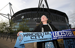 A scarf seller outside the Etihad Stadium, Manchester.