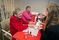 """Connie Wisse enjoys a day of pampering as she has her nails done by Anastasia Merrifield from Empire Beauty School during the Taylor Home's """"Spa Day"""" in their Woodside Building on Wednesday morning.  (Karen Bobotas/for the Laconia Daily Sun)"""