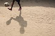 A boy plays with a football (soccer ball) in the Point Four neighborhood of Monrovia, Montserrado county, Liberia on Thursday April 5, 2012.