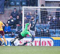 Motherwell's keeper Dan Twardzik drops the ball and Dundee's Gary Irvine scored their third goal.<br /> half time : Dundee 3 v 1 Motherwell, SPFL Premiership played 10/1/2015 at Dundee's home ground Dens Park.