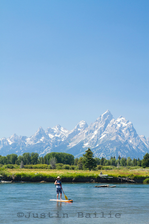 Man on SUP on the Snake River in Grand Teton National Park, WY.