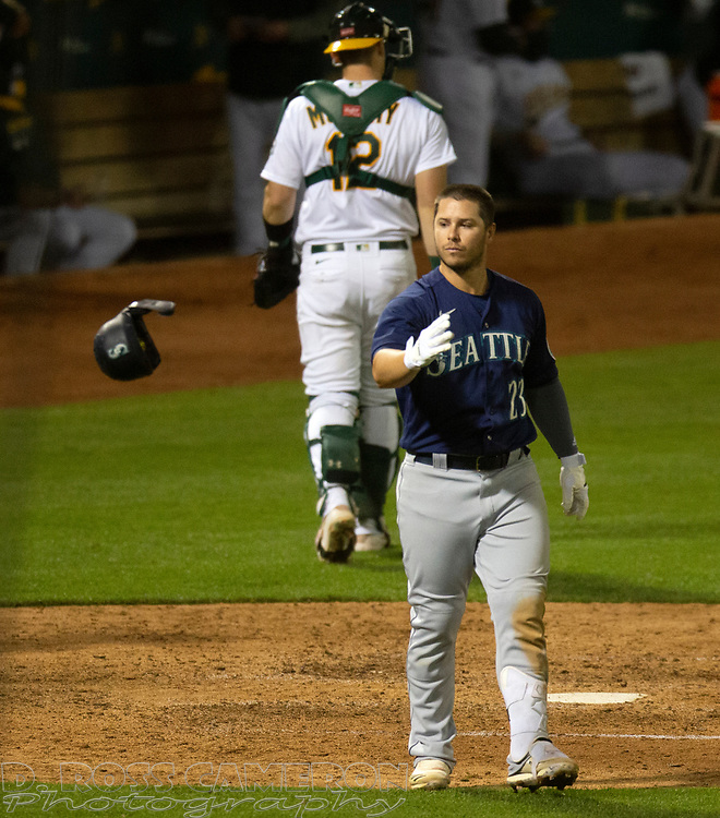 Sep 25, 2020; Oakland, California, USA; Seattle Mariners second baseman Ty France (23) tosses his helmet after striking out during the ninth inning of a Major League Baseball game against the Oakland Athletics at Oakland Coliseum. Mandatory Credit: D. Ross Cameron-USA TODAY Sports