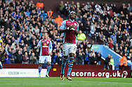 Aston Villa's Christian Benteke reacts after he takes but misses an early penalty. . Barclays Premier League, Aston Villa v Everton at Villa Park in Aston, Birmingham on Saturday 26th Oct 2013. pic by Andrew Orchard, Andrew Orchard sports photography,